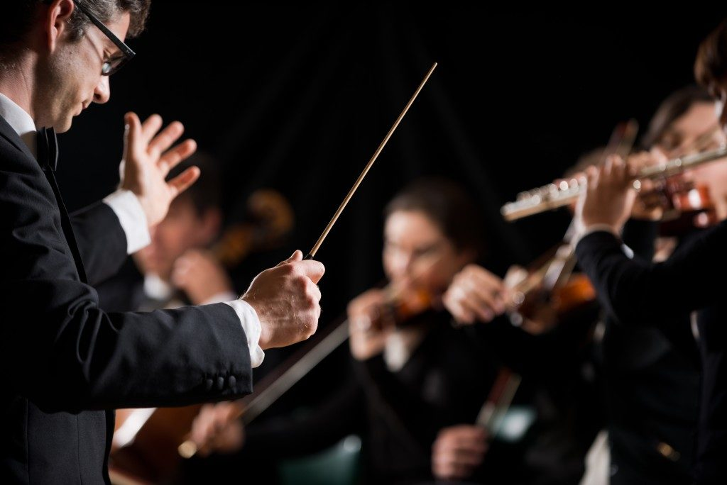 Musical director conducting performance