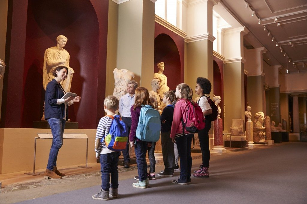 kids having a tour in a museum