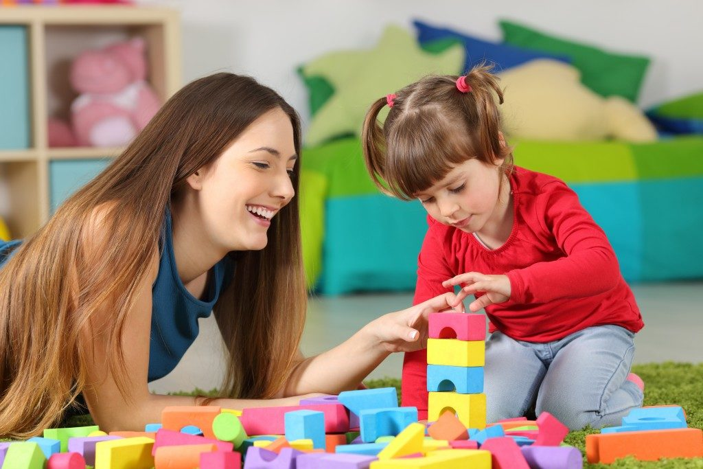 mother playing blocks with her child