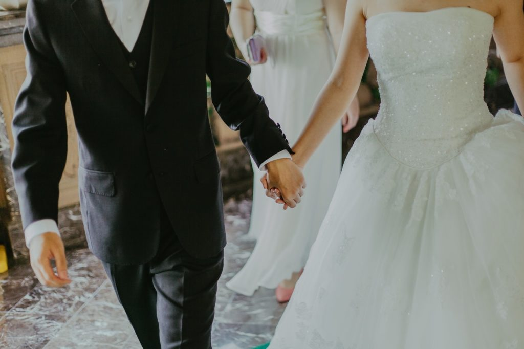 bride and groom holding hands wedding